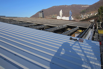 Renovation industrial roof with disposal
