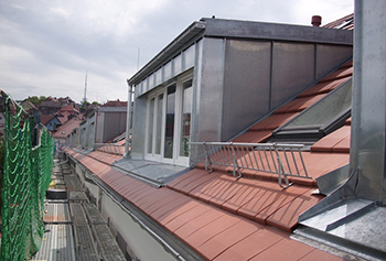 Complete dormer cladding in standing seam system