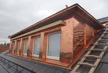 Complete dormer panelling in standing seam system of copper