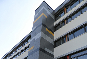 Energy-efficient facade renovation with colored metal panels, subconstruction and thermal insulation