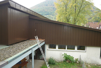 Conversion of original flat roof to pitch roof. Completion of plumbing, metal roof and facade.